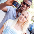 Multiracial couple taking foto — Stock Photo #30756843