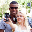 Multiracial couple taking foto — Stock Photo #30757395