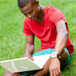 African student with notebook — Stock Photo
