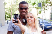 Multiracial couple taking foto — Stock Photo