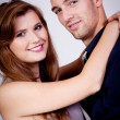 Young attractive couple in love embracing portrait — Stock Photo