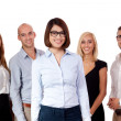 Young successful business team smiling portrait isolated — Stock Photo