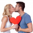 Happy young couple in love with red heart valentines day — Stock Photo #31061479
