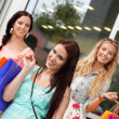 Two attractive young girls women on shopping tour — Stock Photo