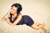 Beautiful asian woman with colorful makeup on the beach — Stock Photo