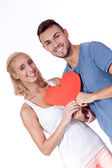 Happy young couple in love with red heart valentines day — Stok fotoğraf