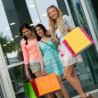 Attractive young girls women on shopping tour — Stock Photo #31656645