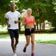 Stock Photo: Young couple runner jogger in park outdoor summer