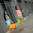 Attractive young girls women on shopping tour — Stock Photo #31659263