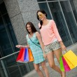 Attractive young girls women on shopping tour — Stock Photo #31659613