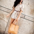Attractive young brunette woman in sexy dress and handbag  — Stock Photo #31660921