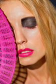Young beautiful woman with smokey eyes and pink lips — Stock Photo