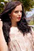 Beautiful brunette woman fashion outdoor in summer — Stock Photo