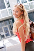 Attractive young blonde woman city lifestyle outdoor — Stock Photo