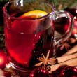 Hot tasty spicy mulled red wine with orange and cinnamon christmas — Stock Photo #34280963