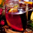 Hot tasty spicy mulled red wine with orange and cinnamon christmas — Stock Photo #34281041