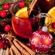 Hot tasty spicy mulled red wine with orange and cinnamon christmas — Stock Photo #34281131
