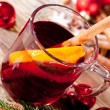 Hot tasty spicy mulled red wine with orange and cinnamon christmas — Stock Photo #34281431