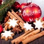 Fresh tasty christmas cinnamon cookies and sticks decoration — Stock Photo #34281535