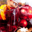 Hot tasty spicy mulled red wine with orange and cinnamon christmas — Stock Photo #34281643