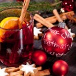 Hot tasty spicy mulled red wine with orange and cinnamon christmas — Stock Photo #34281717