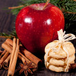 Fresh tasty christmas cinnamon cookies and sticks decoration — Stock Photo