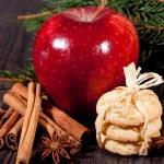 Fresh tasty christmas cinnamon cookies and sticks decoration — Stock Photo #34282021
