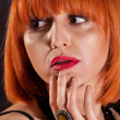 Attractive adult redhead woman with red lips portrait — Photo