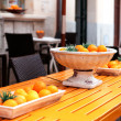 Fresh orange fruits decorative on table in summer — Lizenzfreies Foto