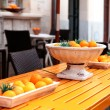 Fresh orange fruits decorative on table in summer — ストック写真