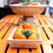 Fresh orange fruits decorative on table in summer — Stock Photo