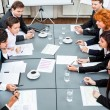 Business team on table in office conference — Stock Photo #34283775