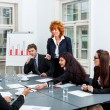 Business team on table in office conference — Stock Photo #34283795