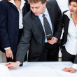 Business people discussing architecture plan sketch — Stock Photo