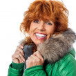 redhead smiling adult mature woman with geen warm jacket — Stock Photo