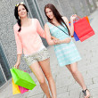 Attractive young girls women on shopping tour — Stock Photo #34286329