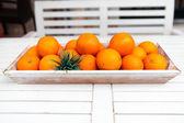 Fresh orange fruits decorative on table in summer — Stock Photo