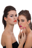 Two beautiful girls with colorful makeup isolated — Stock Photo