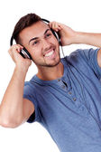 Young attractive man listening to music isolated portrait — Photo