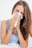Young brunette woman with flu cold influenza — Stock Photo