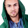 Stock Photo: Young adult mwith green jacket portrait isolated