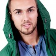 Young adult man with green jacket portrait isolated — Stock Photo
