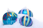 Christmas decoration baubles in blue and turquoise isolated — Stockfoto