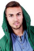 Jeune homme adulte avec portrait de veste vert isolé — Photo