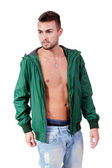 Young adult man with green jacket portrait isolated — Stockfoto