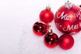 Christmas decoration festive red bauble in snow isolated — Stock Photo