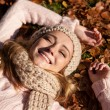Young smiling woman with hat and scarf outdoor in autumn — Stock Photo