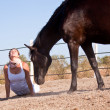 Young woman training horse outside in summer — Foto Stock