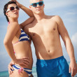 Attractive young couple in swimwear and sunglasses — Stock Photo