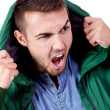 Young adult man with green jacket portrait isolated — Foto Stock